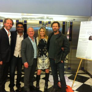 TORN director Jeremiah Birnbaum and producers by the poster on the opening night